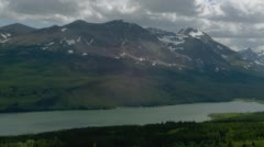View of mountain ranges and Two Medicine Lake in Glacier National Park Stock Footage