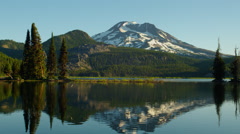 Mount Bachelor reflecting in Sparks lake Stock Footage