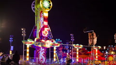 Lunapark amusement ride spinning at night - stock footage