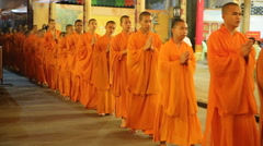 Monks walk in line at chinese temple Stock Footage