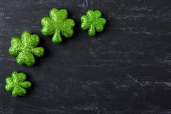 Green clovers on chalkboard background background for st. patrick's day holid Stock Photos