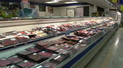 Meat counter butcher shop in grocery store Stock Footage