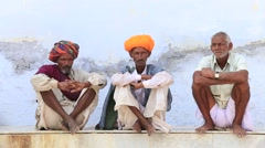 Video 1920x1080  Indian three men, sits along the sacred lake. Pushkar, India Stock Footage