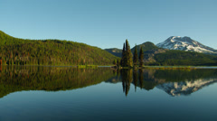 Mount Bachelor reflecting in Sparks lake - stock footage