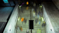 4K timelapse overhead people walking down steps to underground entrance Stock Footage