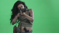 A Female Soldier Aims Her Rifle At The Enemy In Front Of A Green Screen. - stock footage