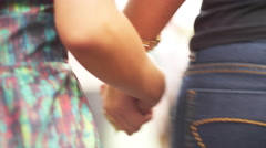 Brazilian mother and daughter holds hands walking down the street Stock Footage