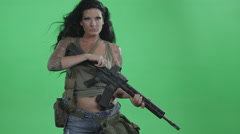 A Female Soldier Cocks Her Rifle For Battle In Front Of A Green Screen. - stock footage