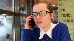 Girl talk to telephone in cafe Stock Footage