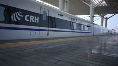 Stock Video Footage of time lapse:Bullet CRH train arriving at a railway station.