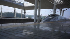 Bullet CRH train arriving at a railway station. Stock Footage