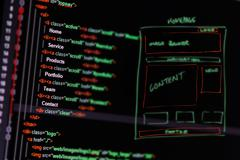 Website development - programming code and wireframe on computer screen Stock Illustration