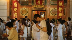 People walk at chinese temple ritual Stock Footage