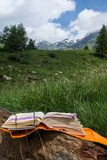 Open book in the mountain Stock Photos