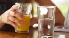 Juice and water on a table at an outdoor cafe Stock Footage