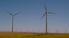 Wind turbines in field near Dalles by Columbia River Stock Footage