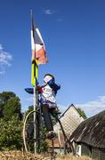 mascot of a cyclist during le tour de france. - stock photo