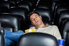Bored Man Sleeping At Theater - stock photo