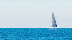 Sailboat sailing in seascape long shot Stock Footage