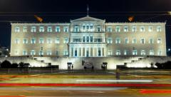4K timelapse Greek parliament building at night with traffic Stock Footage