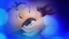 Blue lights and attractive young woman listening to music Stock Footage