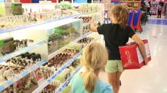 Little boy choosing toys in the shop Stock Footage