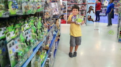 Little boy choosing toys in the shop Stock Footage