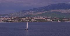4K Yacht sailing coastal watters Stock Footage