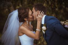 happy couple on wedding day. bride and groom. - stock photo