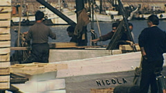 Italy 1970s: fishermen unloadin fish from their boats Stock Footage