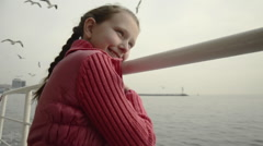 Small white skin ponytail blonde pink jacket girl, banister, on boat ferry trip Stock Footage
