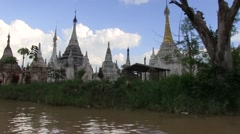 Myanmar, Inle Lake - up the Lake, passing religious momuments. Stock Footage