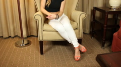 Pan up on beautiful young blonde woman in white jeans Stock Footage