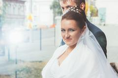 A beautiful bride and handsome groom at church during wedding Stock Photos