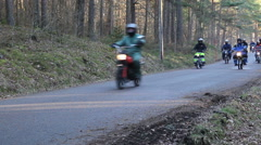 Many trimmed moped go on a tarmac road - stock footage