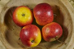 apples in a wooden bowl - stock photo