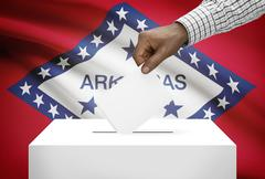 Voting concept - ballot box with us state flag on background - arkansas Stock Photos