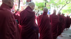 Buddhist monks and novices to receive their meal of the day 02 Stock Footage