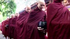 Buddhist monks and novices to receive their meal of the day 01 Stock Footage