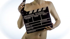 Nude girl with Clapper Board - stock footage