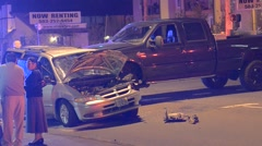 van wrecked with black pickup truck folks standing around - stock footage