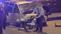 Car wreck medic  set up a gurney on scene flashy lights Stock Footage