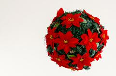 Ball made of fir branches with red flowers. christmas decor Stock Photos