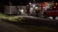 Semi crash over turned semi on the freeway  night shot Stock Footage