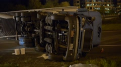 Semi crashed semi on its side showing the  underneath side of the semi Stock Footage
