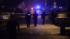 crime scene Police officers walking into a crime scene with police tape - stock footage