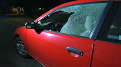 Vandals Bust Window Of A Car Out During A Crime Spree Stock Footage