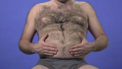 Hairy overweight man playing with his belly. Stock Footage