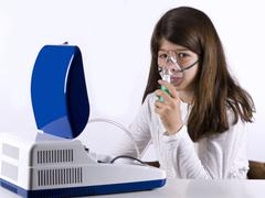 Asthmatic girl, putting on a mask - stock photo