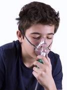 Child putting on a spray on white background Stock Photos